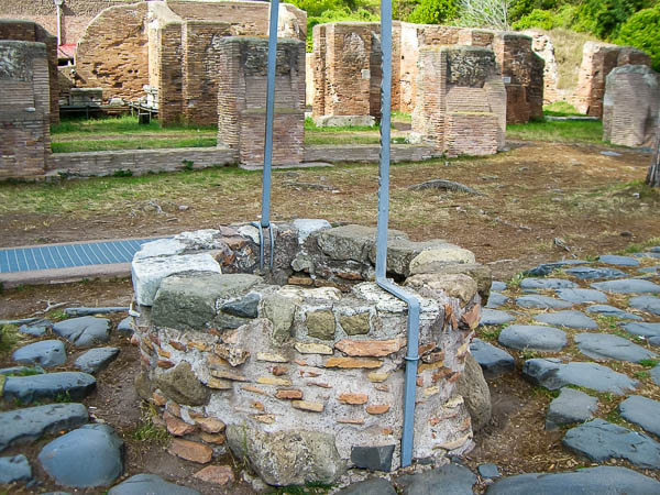A well on the Ostia Antica Decumanus.